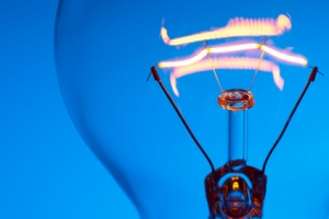 Lit lightbulb with blue background